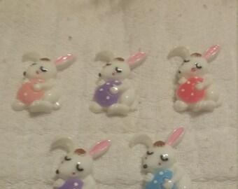 Easter bunny holding an egg flat back resin set of 5.