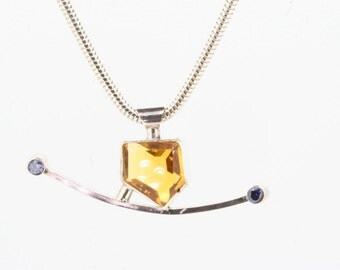 Fancy Citrine and silver pendant