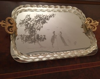 And golden mirror tray