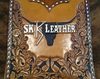 Custom tooled leather clipboard cover, buckstitched, custom tooled lettering.