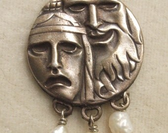 Most Unusual Hand done Artisan Silver Pendant Native American Faces