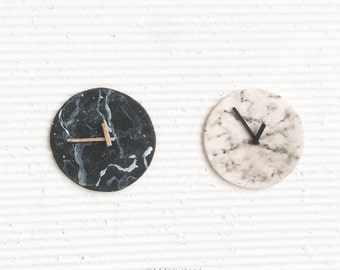 Black and white marble clocks. Realistic dollhouse miniature 1:12