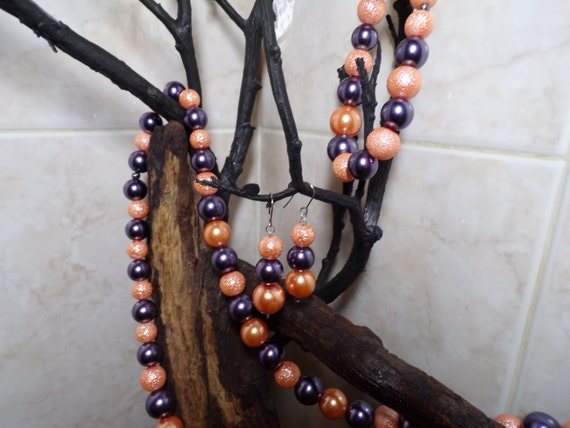 Peacock Purple And Orange Glass Pearls