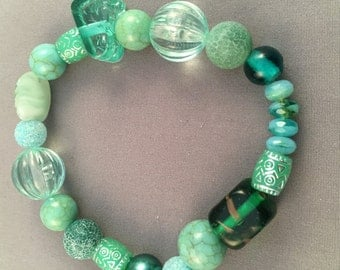 This memory bracelet has Toho beads of browns, creams, green, and dark red beads.