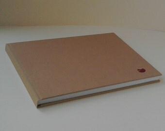 A4 sketchbook landscape tissue interleaved.