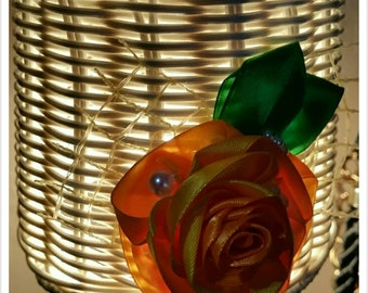 The beautiful small lampshade with handmade ribbon flower.