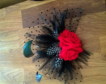 Red rose, black and polka dot feather fescinator