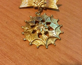 Gold art-deco brooch
