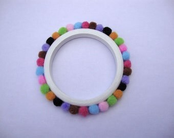 Hand-painted wooden bracelet with colorful pompons.