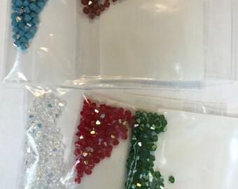 4MM bicone AB in all the colors listed!!!! 100 beads per bag  genuine Swarovski