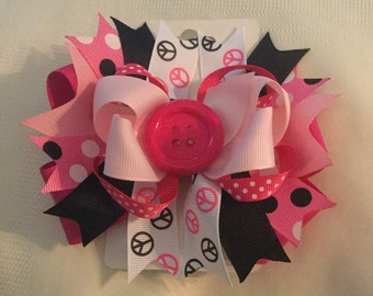 Pink and black peace sign hair bow