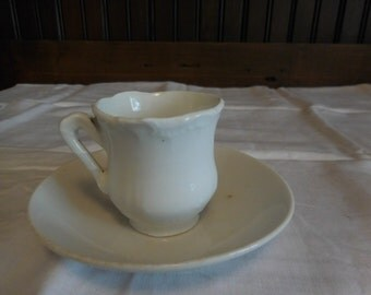 Small Vintage white cup and saucer