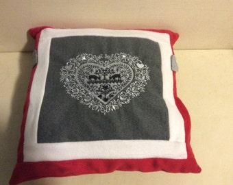 Cloth and fleece pillow with heart