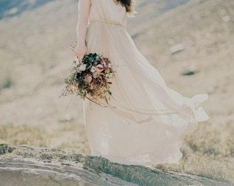 Long dress in beige silk tulle