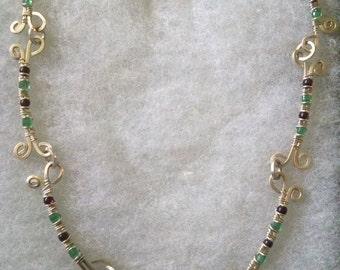topaz, emerald, and garnet necklace