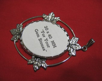 Silver Tone Necklace holds a 30 x 40mm Cabochon