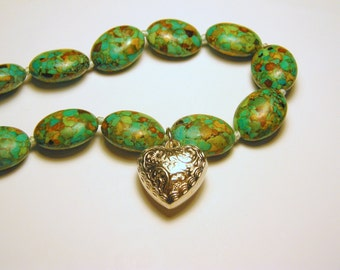 Beaded necklace with ornate silver heart