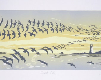 Sunset Gulls: lino cut print of seagulls, sunset, sea, coastline and lighthouse