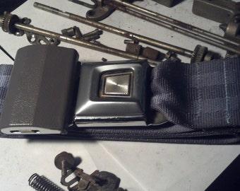 Grey Ford Seatbelt Belt, with adjusting buckle