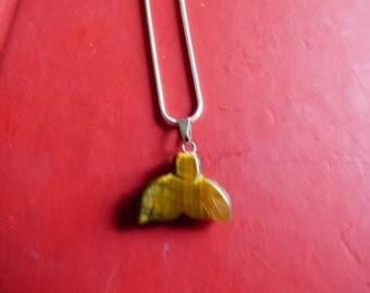 Amber colored semi precious stone on a sterling silver chain