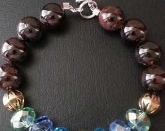 Garnet bracelet with crystals.