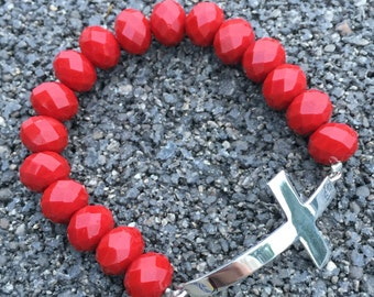 Red beads and cross bracelet