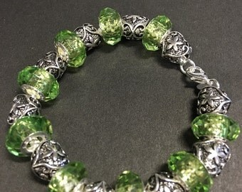 Sterling Silver Bracelet with lime green glass beads and silver spacers.