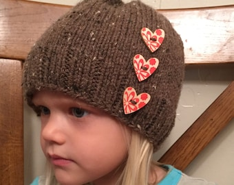 Child size med/lg winter hat with buttons