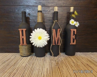 Decorated wine bottles. Decorated HOME set of wine bottles. Home decor.
