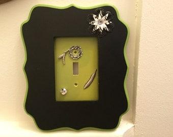 Framed light switch cover