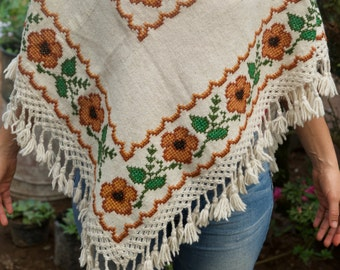 Embroided sunflower huipil