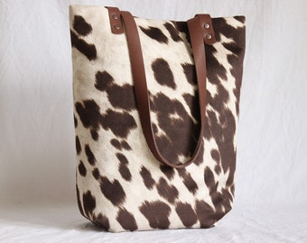 Shoulder bag with leather handles, synthetic fur