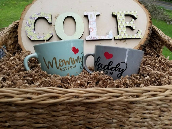 New parent baby shower customizable basket with set of 2 mugs, name plaque, and personalized onesie