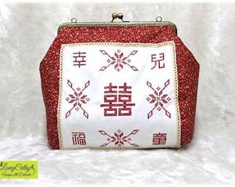 In love with…. Kisslock Handbag with Hong Kong Traditional Baby Sling