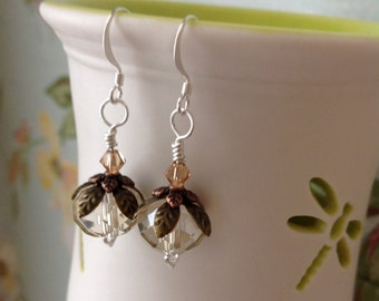 Clear glass bead with brass leaf detail and Swarovski crystal earrings