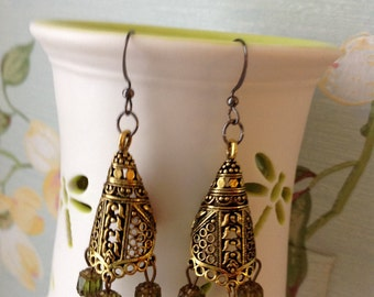 Tribal style antiqued brass cone earrings with green gold Czech glass beads