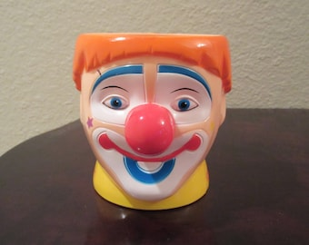 Fun and whimsical vintage plastic Ringling Brothers Barnum and Bailey Circus Clown motif drinking cup. Clown has big red nose & orange hair!