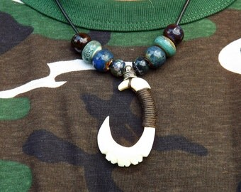 Hand carved Hei Matau style necklace