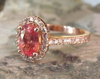 Peach pink champagne sapphire engagement ring.