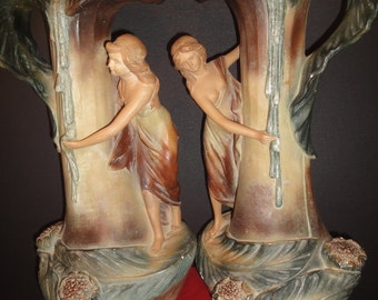 A pair of Art Nouveau pottery vases with maidens on the sides, 45cm