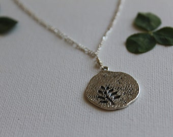 Silver necklace with hollow fern pendant
