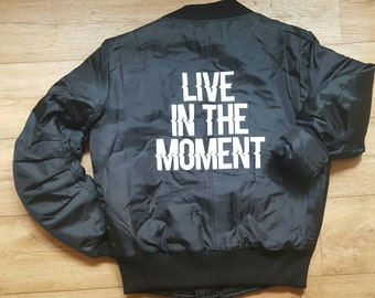 """Women's bomber jacket """"Live in the moment"""". Size XS. Also check houseofaudacious.com for more items."""