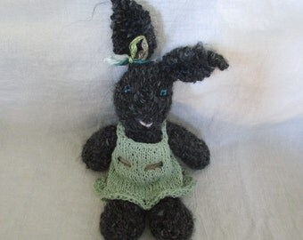 Dark grey bunny rabbit, toy, with moss green dress