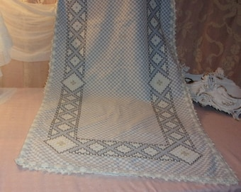 A great old checkered fabric curtain double weave