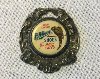 Peter's Shoes Advertising, Poll-Parrott Celluloid Watch Fob, Ca: 1910.