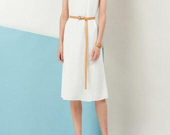 Sleeveless white silk dress
