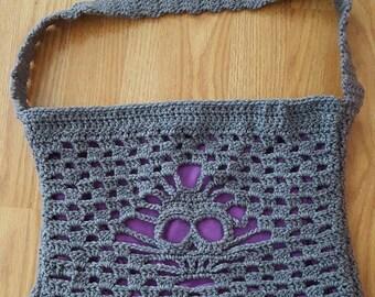 Grey and purple crochet handbag with skull