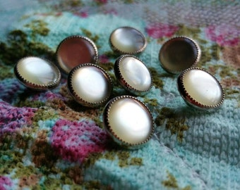 Pearly buttons x 8.  1.2 cm