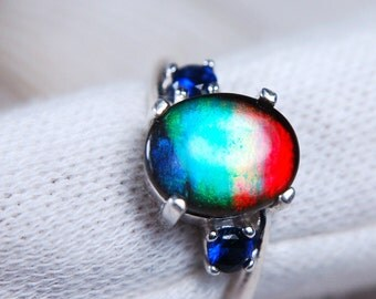 Canadian Grade AA Ammolite ring with natural sapphires in sterling silver.Gorgeous!