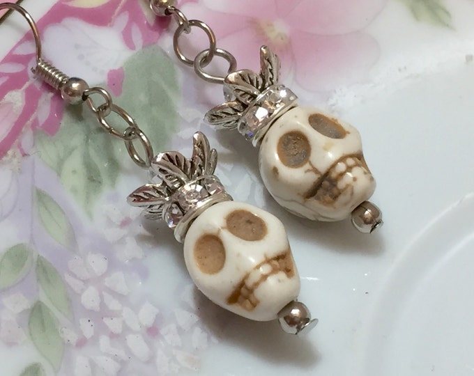 Featured listing image: Day of the Dead Earrings, Rhinestone Crown Skull Earrings, Dia de Los Muertos Jewelry, Creepy Halloween Skull, Morbid Bone Color Howlite